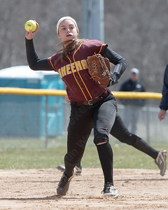 Sheehan's Samantha Iannone throws out Cheshire's Jade Barnes at first Sunday at Pragemann Park in Wallingford April 8, 2018 | Justin Weekes / Special to the Record-Journal