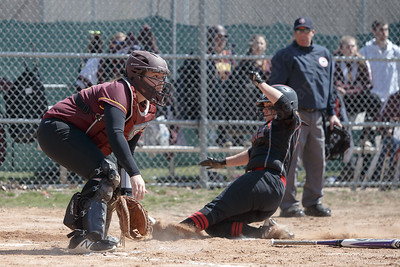 Sheehan's Carolyn Biel waits for the throw as Cheshire's Alexis Hemstock scores Sunday at Pragemann Park in Wallingford April 8, 2018 | Justin Weekes / Special to the Record-Journal