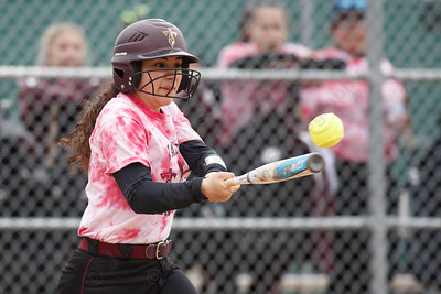 Sheehan's Nicole Dorsey drives a base hit to third Wednesday at Pragemann Park in Wallingford April 18, 2018 | Justin Weekes / Special to the Record-Journal