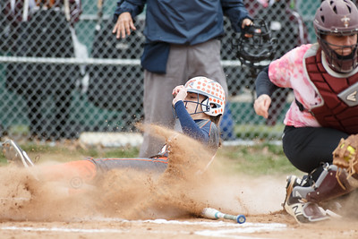 Lyman Hall's Elise Hastings beats the throw home to tie the score Wednesday at Pragemann Park in Wallingford April 18, 2018 | Justin Weekes / Special to the Record-Journal