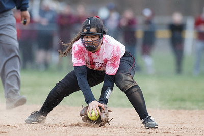 Sheehan's Nicole Dorsey fields a hit from Lyman Hall's Michaela Keating Wednesday at Pragemann Park in Wallingford April 18, 2018 | Justin Weekes / Special to the Record-Journal