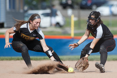 Sheehan's Samantha Iannone left and Nicole Dorsey cross signals on a ground ball Wednesday at Lyman Hall High School in Wallingford May 9, 2018 | Justin Weekes / Special to the Record-Journal