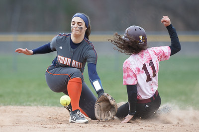 Sheehan's Nicole Dorsey takes second on the late throw to Lyman Hall's Sam Carbone Wednesday at Pragemann Park in Wallingford April 18, 2018 | Justin Weekes / Special to the Record-Journal