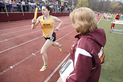 Cheshire's coach Liz Gagliardi calls out a time for Christine Thorp Friday during the Record-Journal Invitational at Sheehan High School in Wallingford April 13, 2018 | Justin Weekes / Special to the Record-Journal