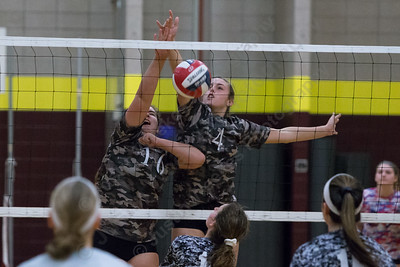 Sheehan's Kayleigh Corless and Samantha Iannone put back a mis hit touch for a kill Wednesday during a Military appreciation game at Sheehan High School in Wallingford October 18, 2017 | Justin Weekes / For the Record-Journal