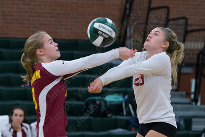 Sheehan's Kari Dietle (18) and Emily Musso nealry collide on a third touch Wednesday at Maloney High School in Meriden October 11, 2017 | Justin Weekes / For the Record-Journal