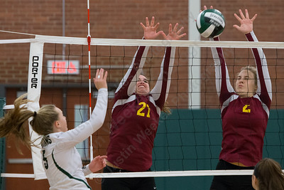 Sheehan's Carolyn Biel and Macey Sundwall (2) block Maloney's Anna Hendrickson Wednesday at Maloney High School in Meriden October 11, 2017 | Justin Weekes / For the Record-Journal
