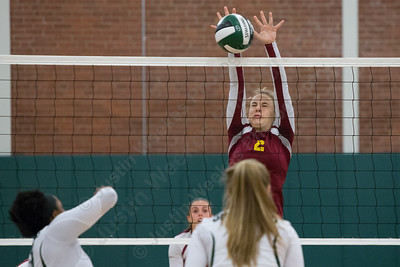 Sheehan's Macey Sundwall blocks a spike from Maloney's Shanice Smith Wednesday at Maloney High School in Meriden October 11, 2017 | Justin Weekes / For the Record-Journal