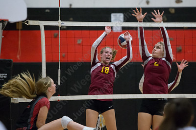 Sheehan's Kari Dietle left and Macey Sundwall gets a piece of Cheshire's Mia Juodaitis spike Thursday during the SCC semifinals at Cheshire High School in Cheshire November 2, 2017 | Justin Weekes / For the Record-Journal