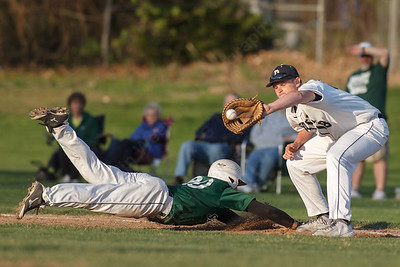 Maloney's Alex Lespier dives back to first beating the tag from Platt's Tristan Arjavich (18) Wednesday at Ceppa Field in Meriden May. 6, 2015 | Justin Weekes / For the Record-Journal