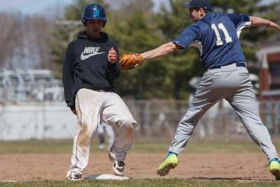 Wilcox Tech's Tevin Robles (15) stands up into third base beating the tag from Platt's Jason Sullivan (11) Saturday at Legion Field in Meriden Apr. 11, 2015 | Justin Weekes / For the Record-Journal