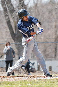 Platt's Dylan Dudley (4) makes contact Saturday at Legion Field in Meriden Apr. 11, 2015 | Justin Weekes / For the Record-Journal