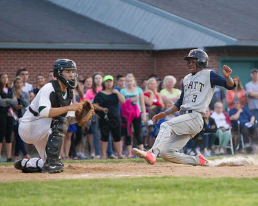 Platt's Jaelin Highsmith (3) slides into home as Maloney's Logan Hayes (14) waits on the throw Tuesday at Ceppa Field in Meriden May. 26, 2015 | Justin Weekes / For the Record-Journal