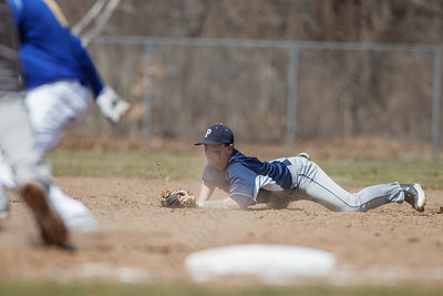 Platt's Gary Costello (2) checks Platt's runner after diving for a ground ball Saturday at Legion Field in Meriden Apr. 11, 2015 | Justin Weekes / For the Record-Journal