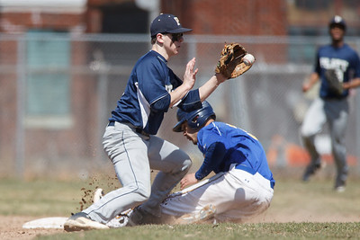 Wilcox Tech's Tevin Robles (15) slides into second base beating the tag from Platt's Gary Costello (2) Saturday at Legion Field in Meriden Apr. 11, 2015 | Justin Weekes / For the Record-Journal