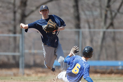 Platt's Cameron Coon (9) tags out Wilcox Tech's Richy Vargas (6) at second before turning the double play at first Saturday at Legion Field in Meriden Apr. 11, 2015 | Justin Weekes / For the Record-Journal