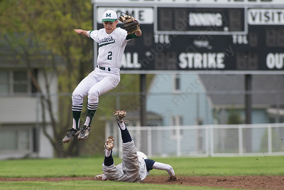 Maloney's second baseman Joseph Gulino jumps for the throw as Platt's Jose Rojas slides into second Saturday at Ceppa Field in Meriden May. 7, 2016 | Justin Weekes / For the Record-Journal