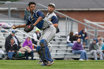 Platt's Jeffrey Morales fields a shot hit from Maloney's Frank Palumbo Saturday at Ceppa Field in Meriden May. 7, 2016 | Justin Weekes / For the Record-Journal