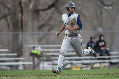 Platt's Jeff Morales checks the throw from O'Keefe's single in the second inning Friday at Legion Field in Meriden Apr. 8, 2016 | Justin Weekes / For the Record-Journal