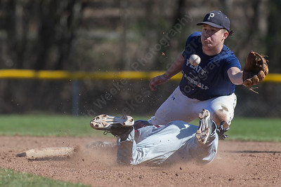Platt's Andrew Abrahante reaches for a throw as Sheehan Sal Gozzo slides into second Wednesday at Platt High School in Meriden Mar. 30, 2016 | Justin Weekes / For the Record-Journal