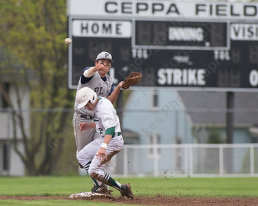 Platt's Andrew Abrahante throws to first after the force on Maloney's Joseph Gulino Saturday at Ceppa Field in Meriden May. 7, 2016 | Justin Weekes / For the Record-Journal