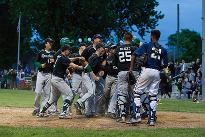 Maloney celebrates Colton Altmannsberger two run shot giving the Spartans the lead in the fifth Monday at Ceppa Field in Meriden May,23 2016 | Justin Weekes For the Record-Journal