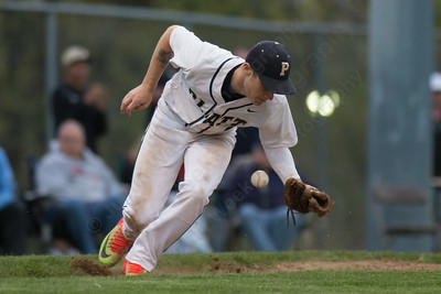 Platt's Jonathan Cahill bobbles fielding a hit from Maloney's Matthew Anzolletti  Monday at Ceppa Field in Meriden May. 1, 2017 | Justin Weekes / For the Record-Journal