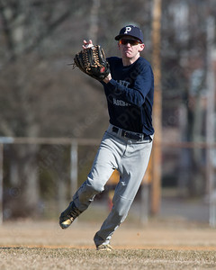 Platt's Carson Coon fields a hit Thursday during a scrimmage at West Side field in Wallingford Mar. 30, 2017 | Justin Weekes / For the Record-Journal