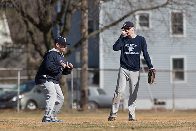 Platt's head coach Tim Redican talks with Carson Coon Thursday during a scrimmage at West Side field in Wallingford Mar. 30, 2017 | Justin Weekes / For the Record-Journal