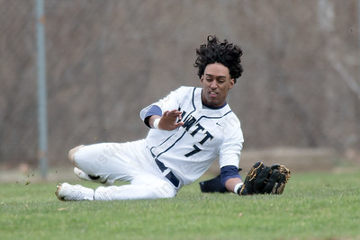 Platt's Ethan Dudley makes a sliding catch in center Friday at Legion Field in Meriden Apr. 7, 2017 | Justin Weekes / For the Record-Journal
