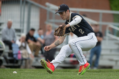 Platt's Jonathan Cahill charges a Maloney bunt Tuesday at Ceppa Field in Meriden May. 23, 2017 | Justin Weekes / For the Record-Journal