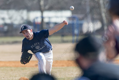 Platt's Devyn McCarty delivers a pitch Thursday during a scrimmage at West Side field in Wallingford Mar. 30, 2017 | Justin Weekes / For the Record-Journal