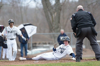 Platt's Cameron Coon slides into home Friday at Legion Field in Meriden Apr. 7, 2017 | Justin Weekes / For the Record-Journal