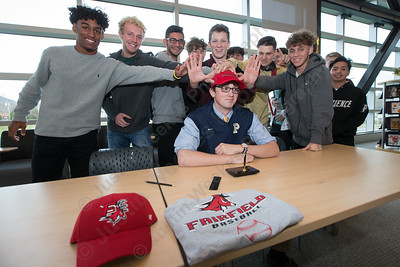 Platt's Carson Coon, surrounded by his baseball teammates signs his letter of intent for Fairfield University Monday at Platt High School in Meriden November 13, 2017 | Justin Weekes / For the Record-Journal