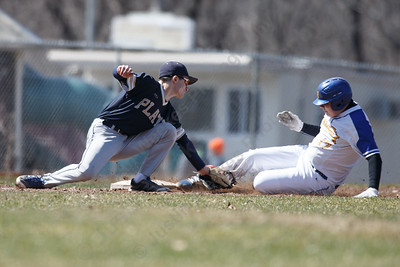 Platt's Jonathan Avitable gets Wilcox Tech's Sean Dupuis at third Saturday at Legion Field in Meriden April 7, 2018 | Justin Weekes / Special to the Record-Journal