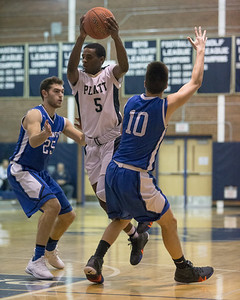 Platt's Elijah Wright tries to split the defense Tuesday at Platt High School in Meriden January 22, 2019 | Justin Weekes / Special to the Record-Journal