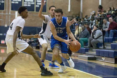 Southington's Jacob Flynn dribbles out of a trap Tuesday at Platt High School in Meriden January 22, 2019 | Justin Weekes / Special to the Record-Journal
