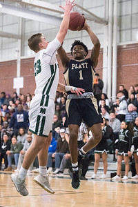 Platt's Tremayne Carter puts up a shot Tuesday at Maloney High School in Meriden February 19, 2019 | Justin Weekes / Special to the Record-Journal