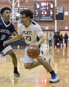 Platt's Anthony Lorenzo drives past Middletown's Kenneth Fountain Thursday at Platt High School in Meriden February 7, 2019 | Justin Weekes / Special to the Record-Journal