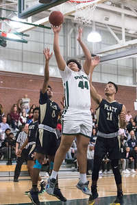 Maloney's Anthony Forbes puts back a rebound Tuesday at Maloney High School in Meriden February 19, 2019 | Justin Weekes / Special to the Record-Journal
