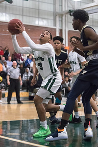 Maloney's Vincent Martinez reaches for a rebound Tuesday at Maloney High School in Meriden February 19, 2019 | Justin Weekes / Special to the Record-Journal