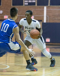 Platt's Elijah Wright looks to drive past Southington's Jared Kelly Tuesday at Platt High School in Meriden January 22, 2019 | Justin Weekes / Special to the Record-Journal