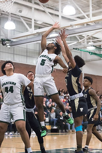 Maloney's Divine Ransom puts in a shot Tuesday at Maloney High School in Meriden February 19, 2019 | Justin Weekes / Special to the Record-Journal