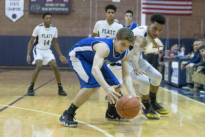 Southington's Jacob DelMonte and Platt's Romello Leary fight for a loose ball Tuesday at Platt High School in Meriden January 22, 2019 | Justin Weekes / Special to the Record-Journal