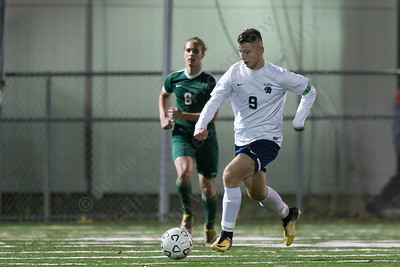 Platt's Hubert Brzoza pushes up field Monday at Falcon Field in Meriden October 30, 2017 | Justin Weekes / For the Record-Journal