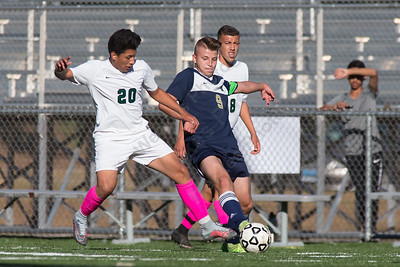 Maloney's Denis Blandon challenges Platt's Hubert Brzoza Monday at Falcon Field in Meriden October 2, 2017 | Justin Weekes / For the Record-Journal