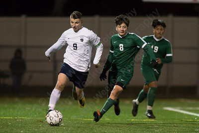 Platt's Hubert Brzoza and Maloney's Ismael Mendez challenge for possession Monday at Falcon Field in Meriden October 30, 2017 | Justin Weekes / For the Record-Journal