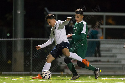 Platt's Luis Santibanez  and Maloney's Christian Dominguez  battle for possession Monday at Falcon Field in Meriden October 30, 2017 | Justin Weekes / For the Record-Journal