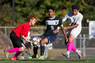 Maloney's goalie Devin Jaun comes out to challenge Platt's Colby Rintharamy  Monday at Falcon Field in Meriden October 2, 2017 | Justin Weekes / For the Record-Journal