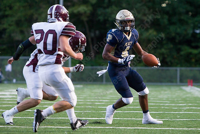 Platt's EJ Dudley looks to turn up field Friday during the season opener at Falcon Field in Meriden Sep. 8, 2017 Platt defeated Farmington 42 to 7.   Justin Weekes / For the Record-Journal